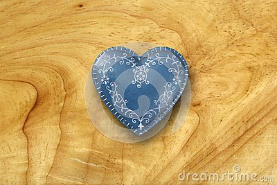 Blue heart on old wood background