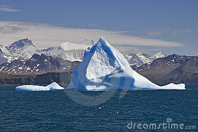 Blue iceberg with land