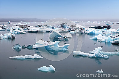 Blue icebergs floating in Jokulsarlon glacial lagook, Iceland