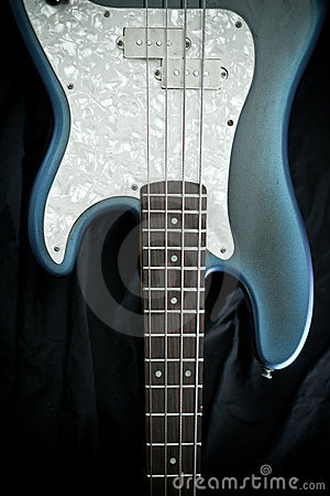 Blue and ivory bass guitar