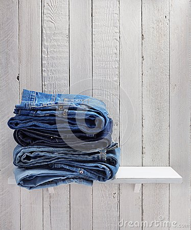 Free Blue Jeans On Wooden Shelf Stock Photography - 120466922