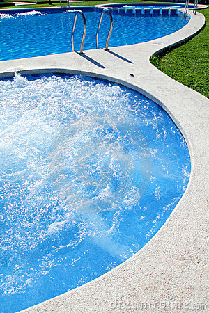 Blue jet spa pool in green grass garden