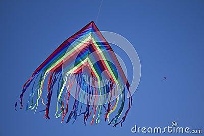 Blue kite in blue sky