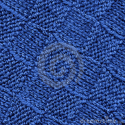 Blue knitted wool pattern texture background.