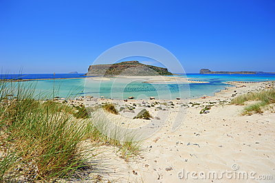 Blue lagoon and white sand dunes