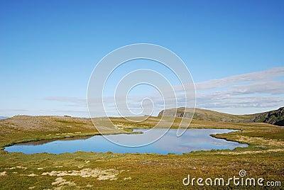 Blue lake on the green hill of Soroya.