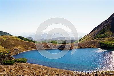 Blue Lake in volcanic terrain, Chile