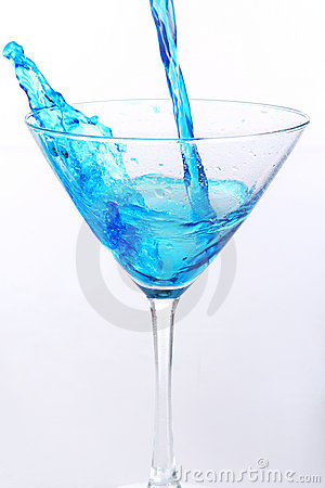 Blue liquid pouring into glass