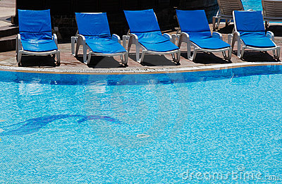 Blue lounges at pool