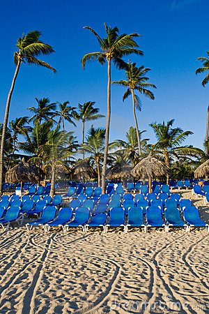 Blue lounges on a sand beach