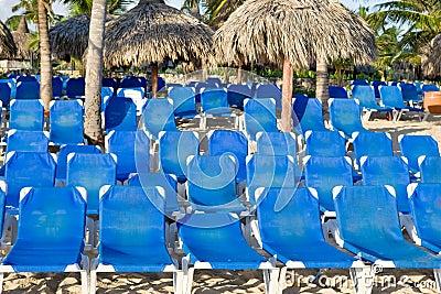 Blue lounges on a sand beach