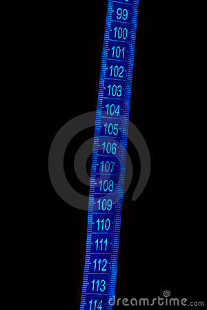 Blue measuring tape against dark background