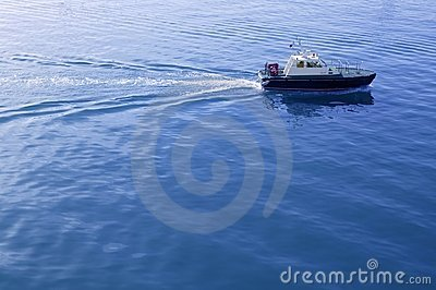 Blue Mediterranean Sea with pilots boat