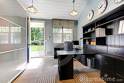 Blue modern home office with dark brown furniture.