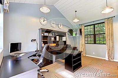 Blue modern home office with dark brown furniture.
