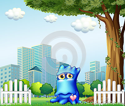A blue monster standing near the fence across the tall buildings