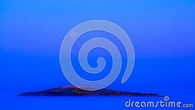 Blue moonset and sunrise Stock Photo