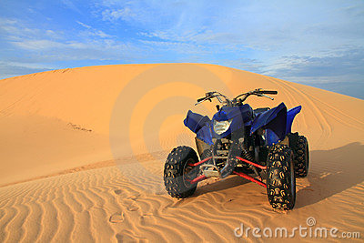 Blue Motor Bike at Sand Dune