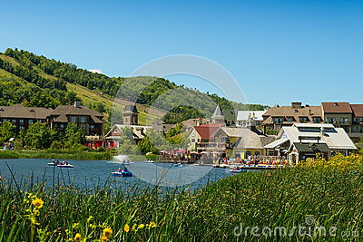Blue Mountain Village with restaurants and a pond Editorial Image