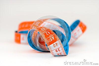 Blue and orange  measuring tape