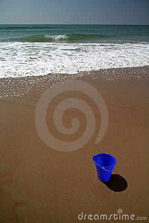 Blue pail on the beach