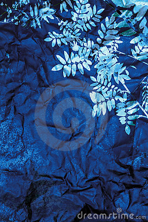 Blue paper with silver leaves