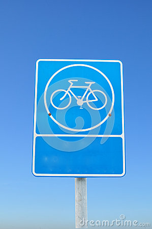 Blue parking bicycle sign on blue sky background.