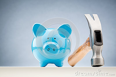 Blue Piggy Bank and a Hammer