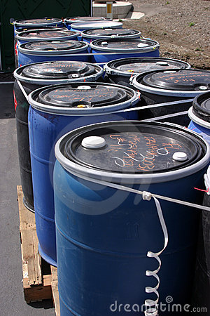 Free Blue Plastic 55 Gallon Drums Full Of Various Flammable Waste At A Recycling Plant Royalty Free Stock Photos - 572098