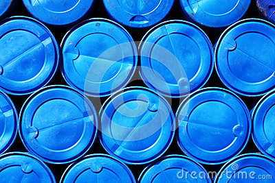 Blue plastic barrels containing chemicals