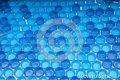 Blue plastic bottle caps