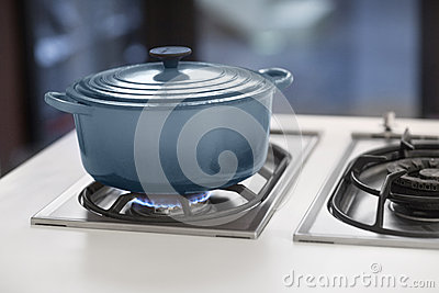 BLUE POT ON A GAS STOVE