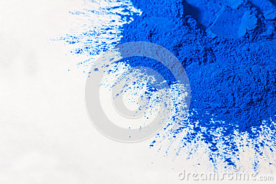 Blue powder on white