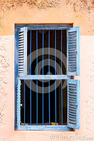 Blue Prison Bars And Wooden Louvred Shutters