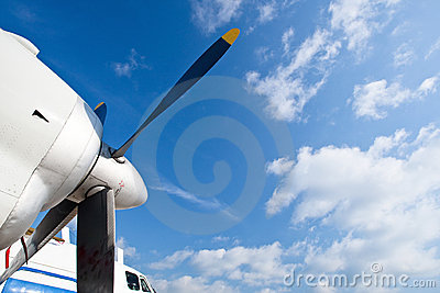 Blue propeller of white airplane