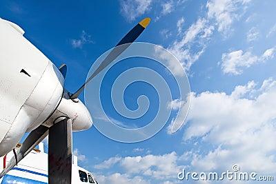 Blue propeller of white airplane