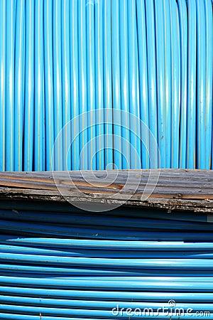 Blue pvc long tube on  spool
