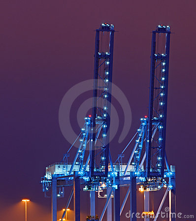 Blue quay cranes at night