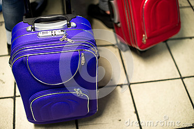 Blue and Red Suitcases