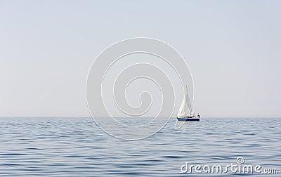 Blue sail boat at sea or ocean