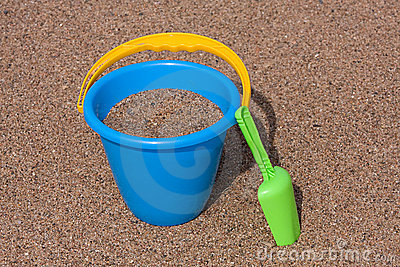 Blue Sand Bucket & Green shovel on the beach