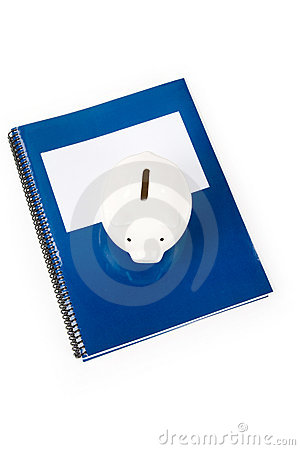 Blue school textbook and piggy bank
