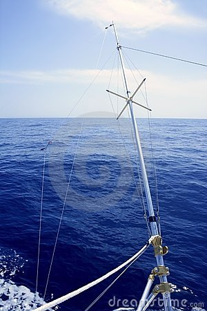 Blue sea with outrigger fishing boat equipment