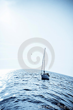 Blue sea with sailboat