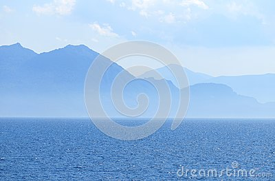Blue sea scape with mountains