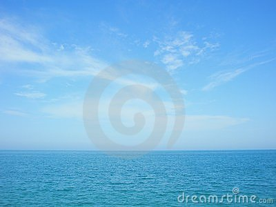 Blue sea and sky horizon with clouds