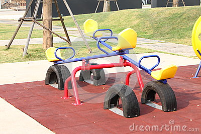 Blue seesaw and yellow seat for the kid