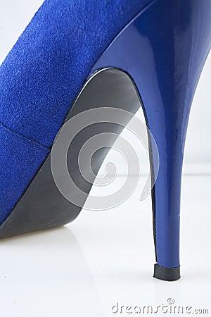 Blue shoe against white background