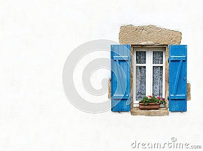 Blue shuttered window on white