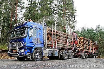 Blue Sisu Polar Timber Truck Hauls Timber